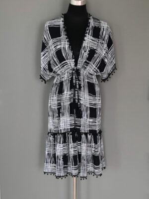Kjole i sort-hvid tern med pompon - for